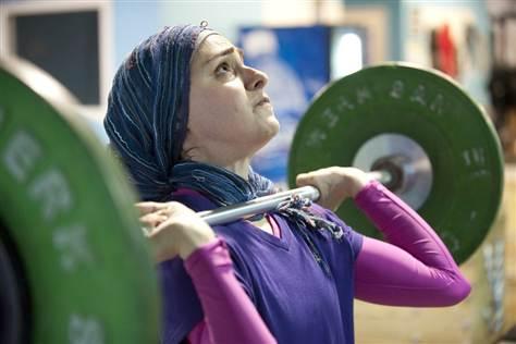 http://tundratabloids.com/wp-content/uploads/2011/06/hijab-weight-lifter-28.6.2011.jpg