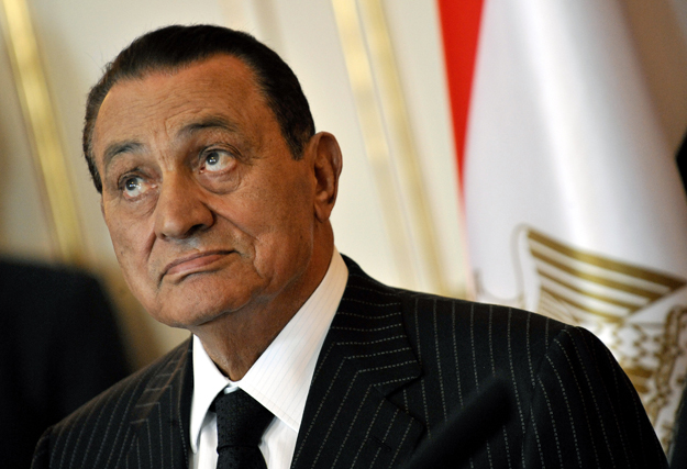 Egyptian President Hosni Mubarak gives a