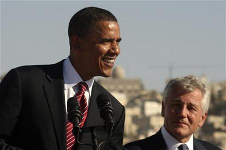 US Democratic presidential candidate Senator Obama smiles next to US Senator Hagel during news conference at the Amman Citadel