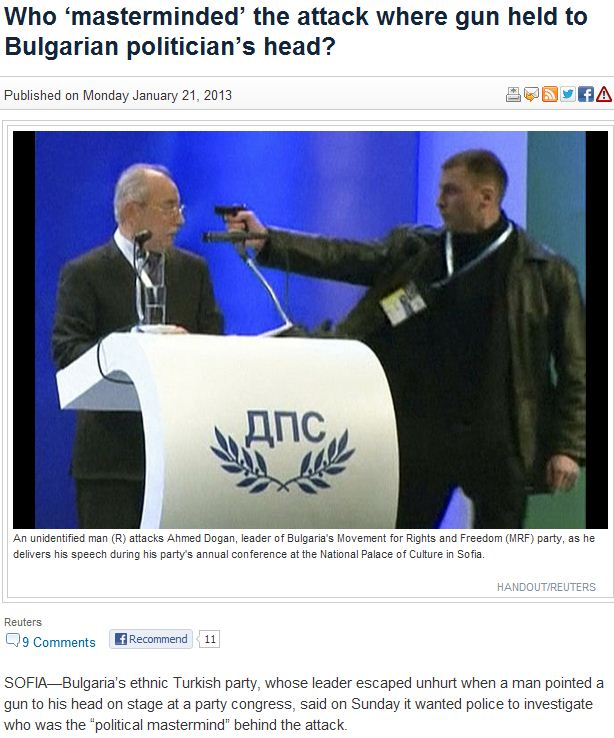muslim crazy man with toygun on stage with muslim politician 22.1.2013