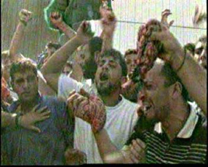 arabs.waving.entrails.butchered.israelis.ramallah
