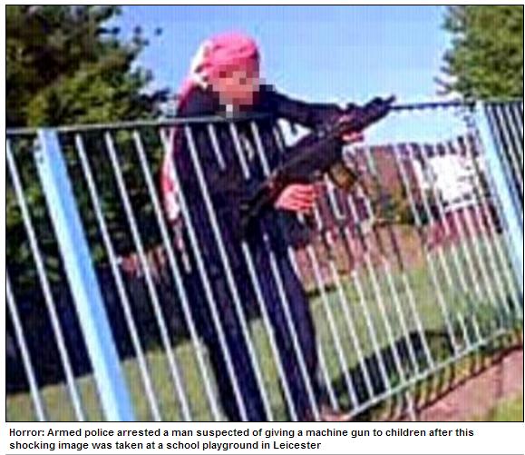 tard hands machine gun to kid at school playground 9.6.2013