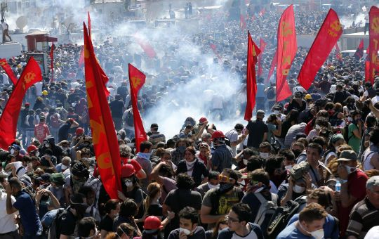 Riot police use tear gas to disperse demonstrators during an anti-government protest at Taksim square in central Istanbul