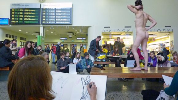 NAKED MODEL IN TRAIN STATION