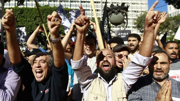 "Supporters of the Islamist party ""Hizb Ut-Tahrir"" movement chant slogans during a rally at central Habib Bourguiba Avenue, in Tunis"