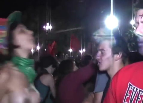 argentinian lesbian activist spits in the face of a man praying the rosary 2.12.2013