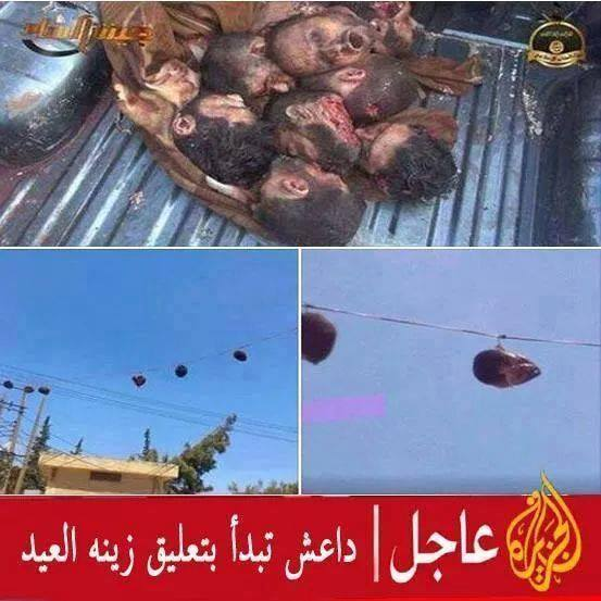 ISIS HANGS HEADS ON WIRES