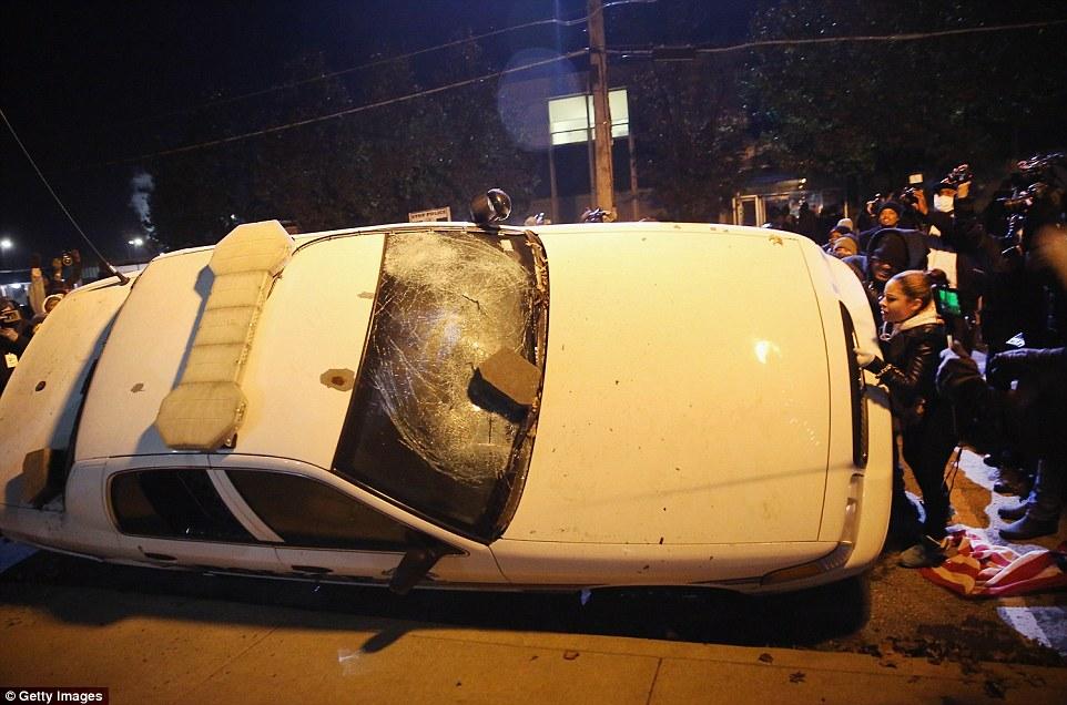 ferguson cop car turned over
