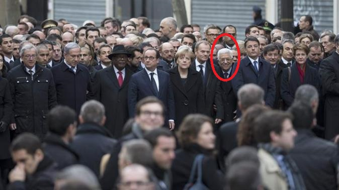 Abbas smiles at paris march