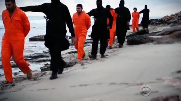egyptian copts marched by isis to be beheaded