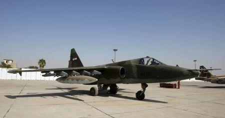 The Sukhoi Su-25 aircraft is seen loaded with bombers at an air base in Baghdad