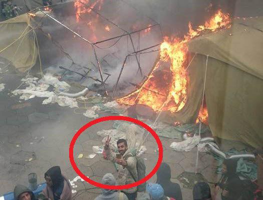 tard selfie in burning tent camp
